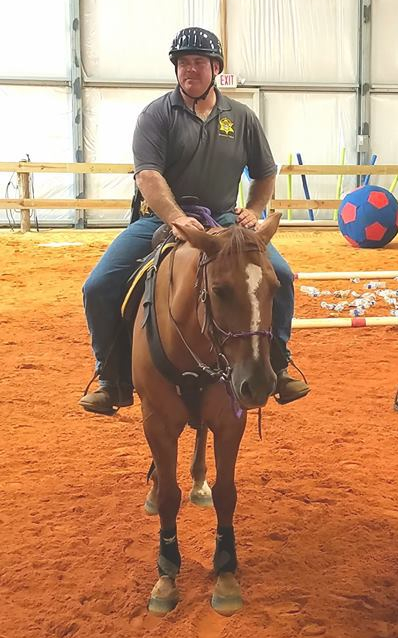 Corporal Mark McCarter from York County Sheriff's office conducted the August mounted training